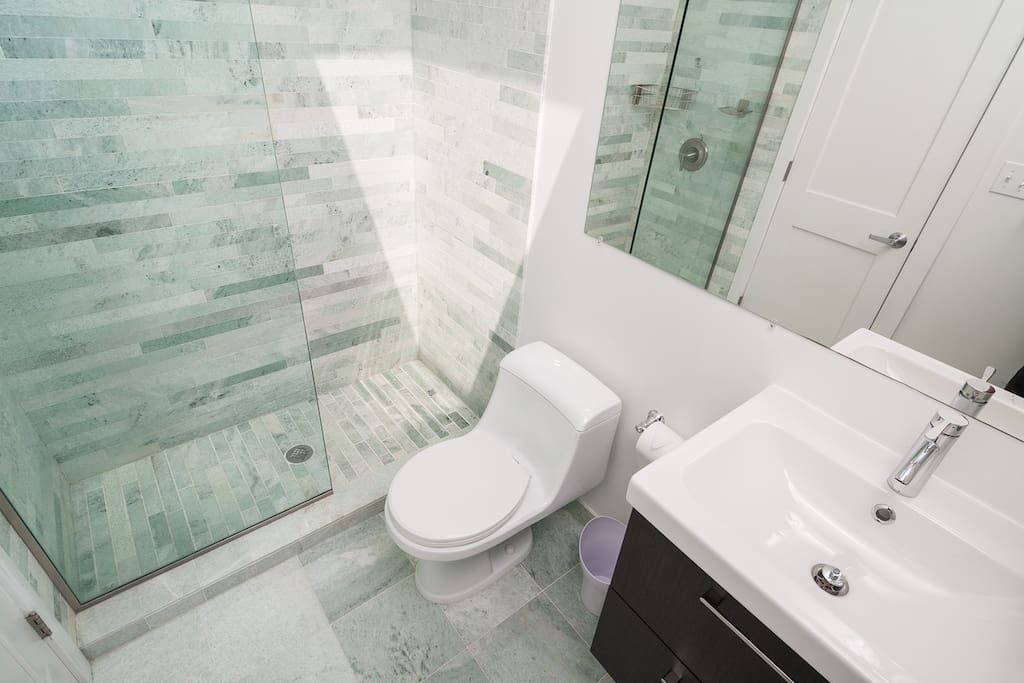 Spa like bathroom with full marble shower and a skylight.  Top quality towels and bath products are provided.