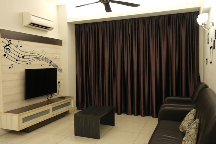 Living area with sofa and flat screen TV