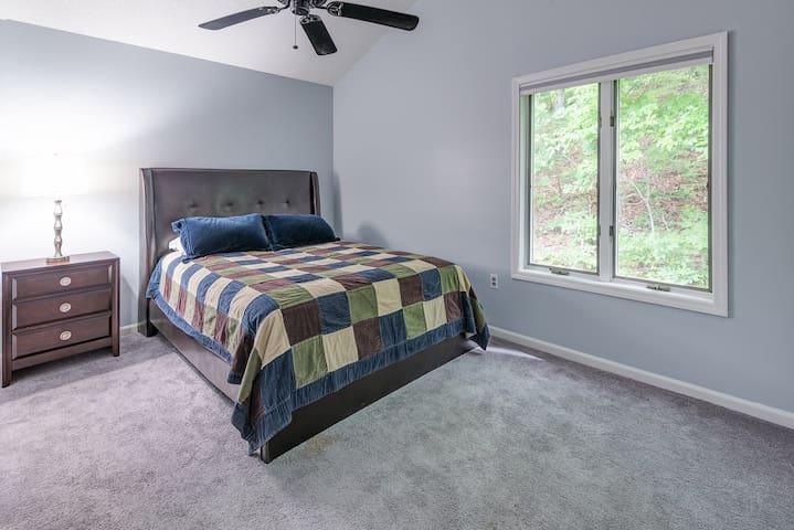 A third and lovely queen bed bedroom.