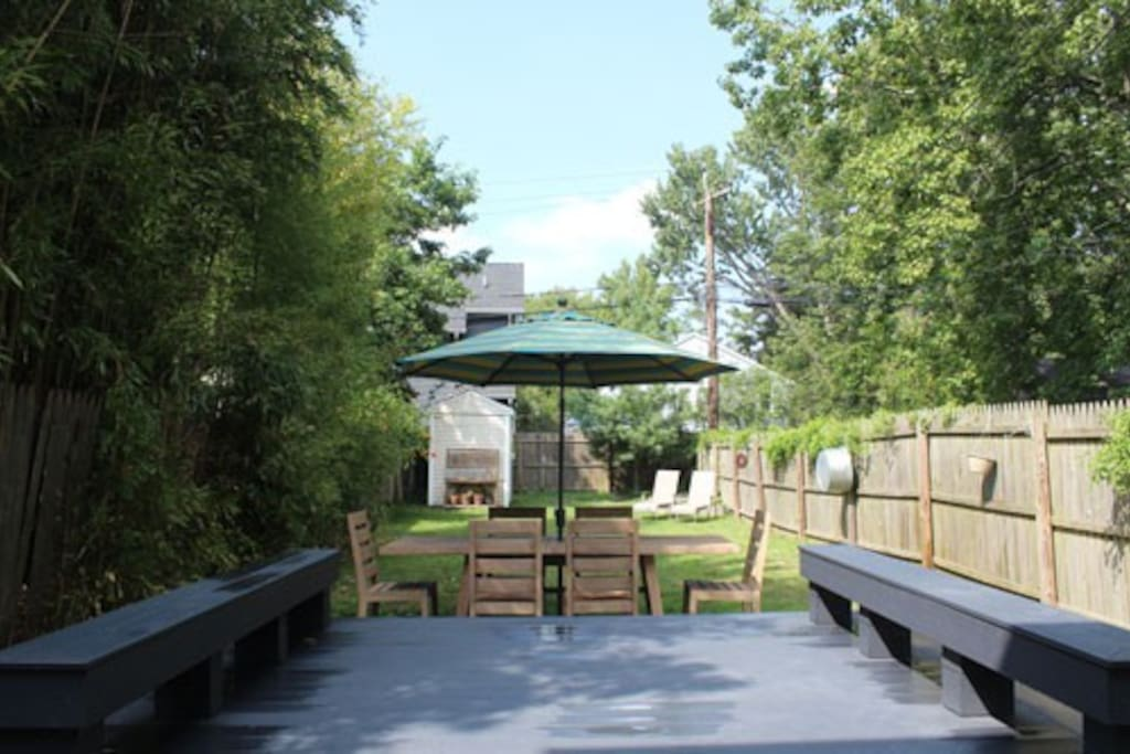 Relax in the backyard...table with umbrella seats 8, plus casual deck seating. Gas grill for BBQ. Shed with bikes, yard games, kids' pool and toys.