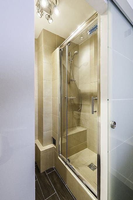 Photo of shower. This photo is from a twin apartment and the shower in my studio is very very similar in every way (except the lamp in the ceiling)