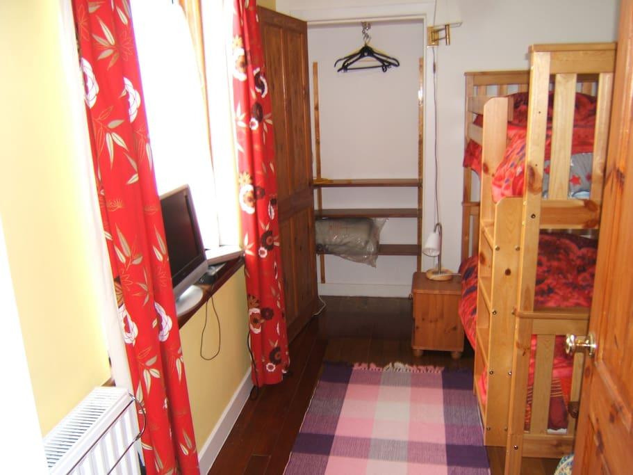 Bunk bedroom with built in wardrobe, twin bunk beds