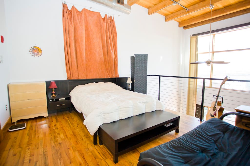 The master suite is located upstairs in an open air loft style layout
