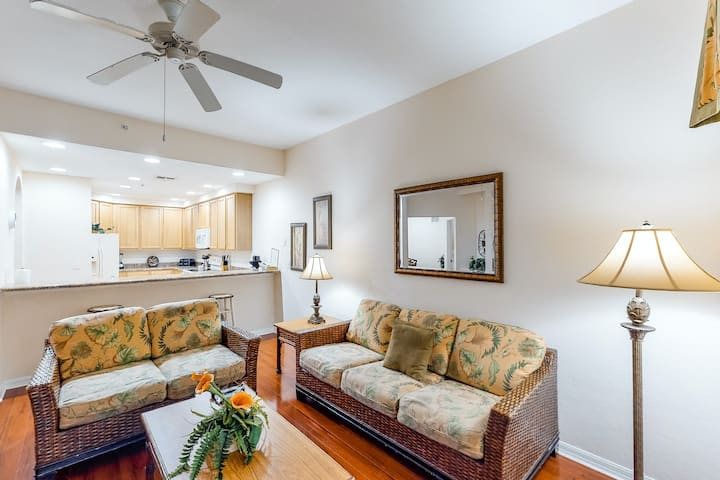 1st floor condo w/ patio, shared pools, gym, limited-mobility access, & sauna