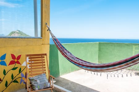 This guest house is situated in a small community overlooking Copacabana - you are welcome to stay with this local Carioca (Rio) family who have lived here for generations.  Breakfast on the terrace is included in the price for 2 guests. Welcome!