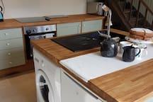 New washing machine and fridge with freezer