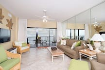 The living area has access to the stunning balcony through a sliding glass door.