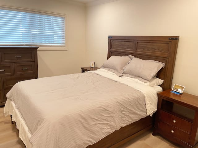 Bedroom 3 has a queen size bed with a large dresser and also a google home display. It also has a closet for your usage.