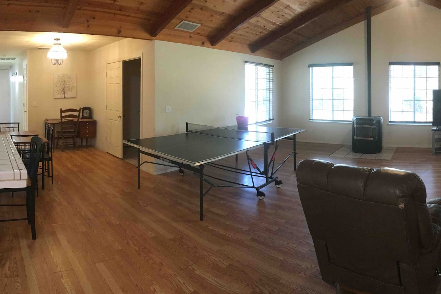 Come enjoy a fun game of ping pong with friends and family in our spacious living room, while watching NFL Sunday ticket on direct tv.