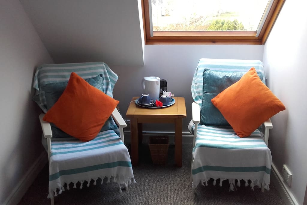 LOVELY SEATING AREA TO RELAX WITH TEA OR COFFEE AND A BOOK