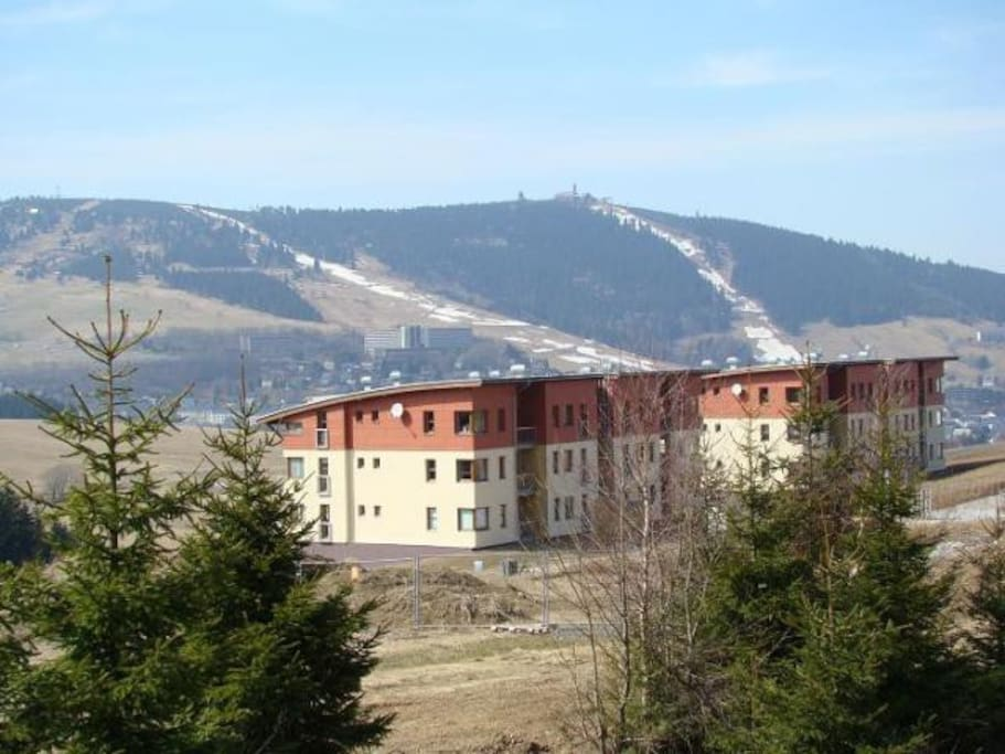 From the place, there is a fantastic view, of the german mountain resort Oberwiesenthal (2 km). For tourists there is open pedestrian border crossing over the stream Polava that connects the town Loučná with the german mountain village.