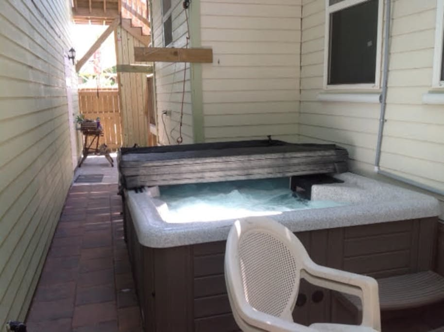 Hot tub secluded in the backyard.