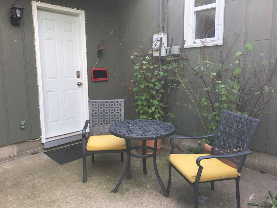 Small table and chairs near front door.