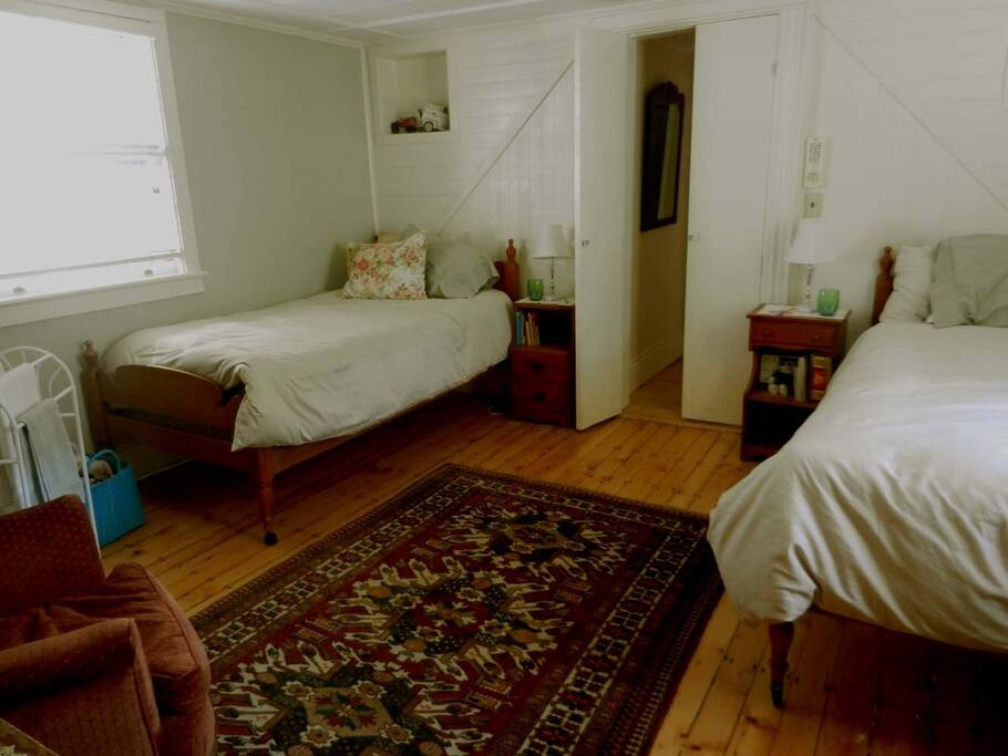 Your  bedroom with 2 twin beds -view toward  door to hall and shared bathroom