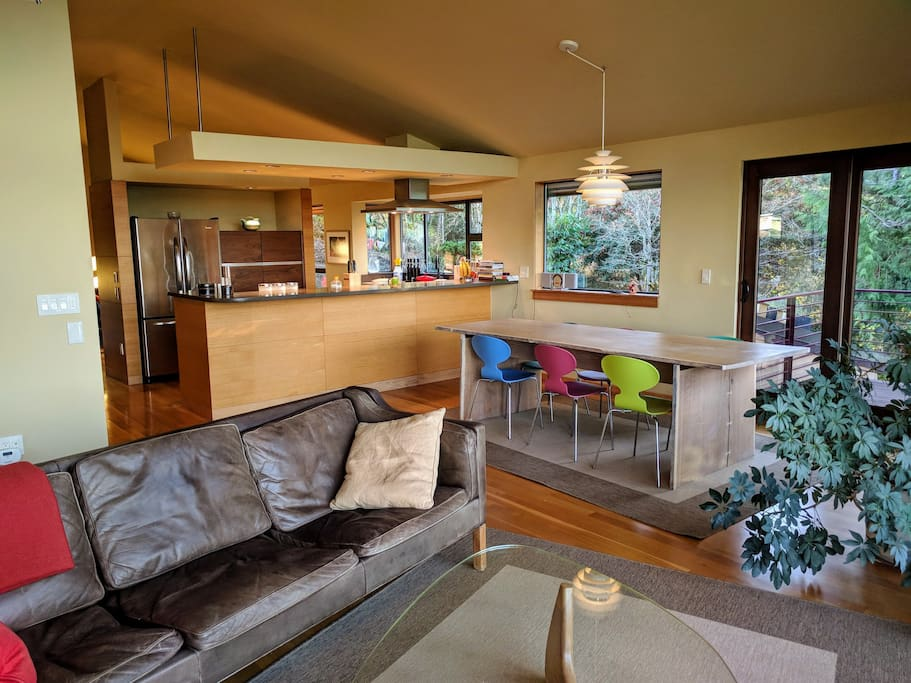 Living and dining space with kitchen in the background