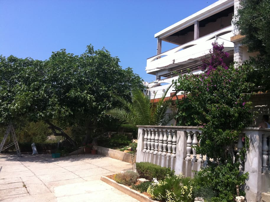 Free parking is secured in front of the villa surrounded with lush mediteranean garden