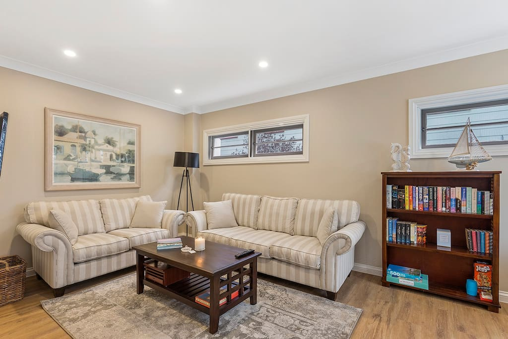 The front lounge room is a peaceful relaxing room to watch TV or take in the waterviews from the front windows.