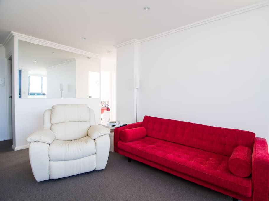 Comfy lounge and leather recliner chair in living room