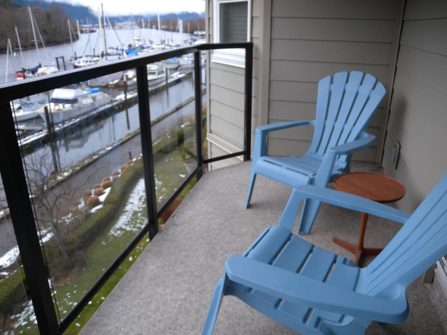 Sunny private deck with views of the waterfront and the Chief