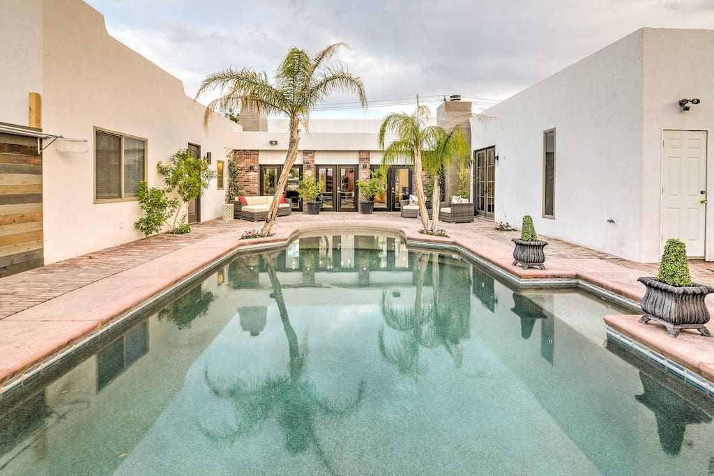 Spend your days lounging around the pool in this desert oasis.