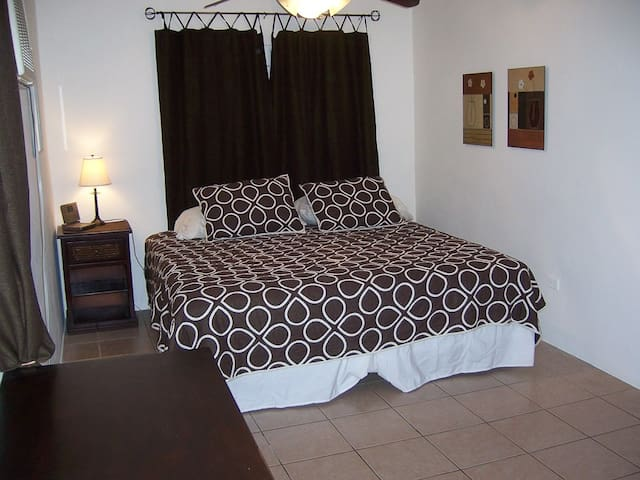 Master bedroom w/ King bed, futon, TV and DVD Player, 50+ movies, AC