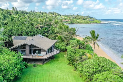 Beachfront estate w/ a private hot tub & a beautifully landscaped yard