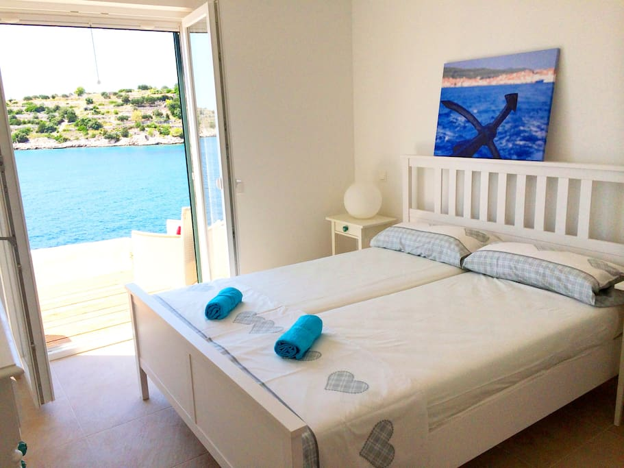 Romantic first bedroom accompanied by charming mediterranean details and exit to the terrace