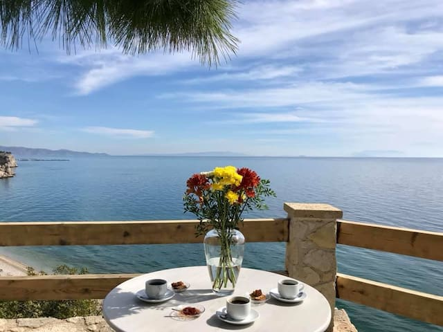We can't think of a better start to your vacation than relaxing in our garden with a refreshing drink overlooking the Saronic Gulf!