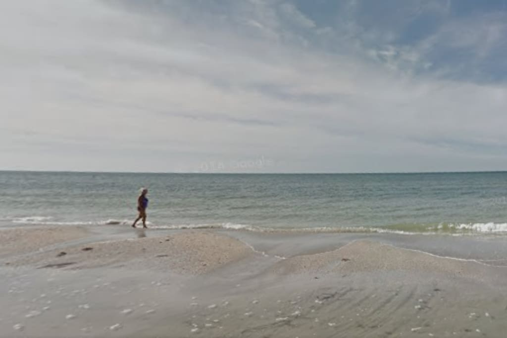 Take a stroll on the soft sugar sands of Madeira beach, steps from condo