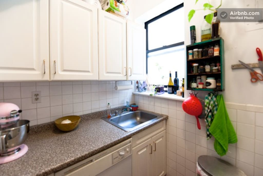 Kitchen - fully equipped with a full-size stove, oven, fridge, microwave and dishwasher.