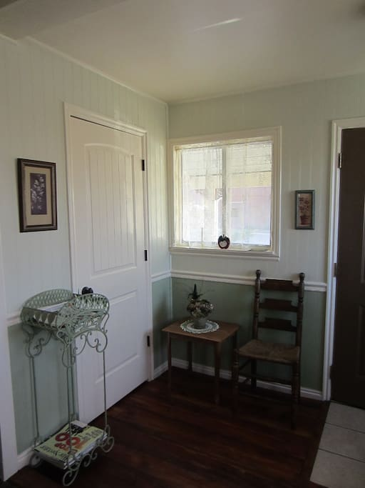The entry way welcomes you with a place to remove your shoes and store your belongings.
