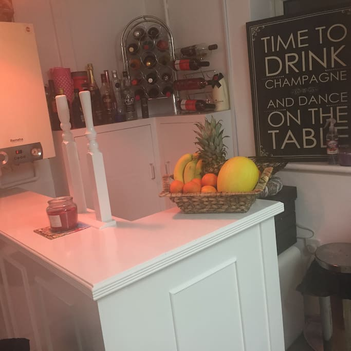 A mini home bar  the guest can buy their drink and have it on the bar while listening to some cool music