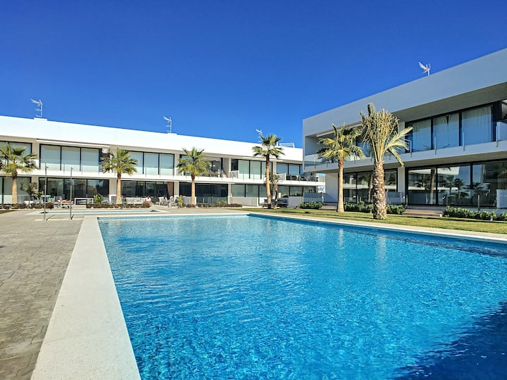 Modern penthouse apartment, pool and sea views