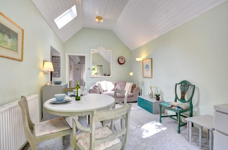 Living and dining space, vaulted ceiling.