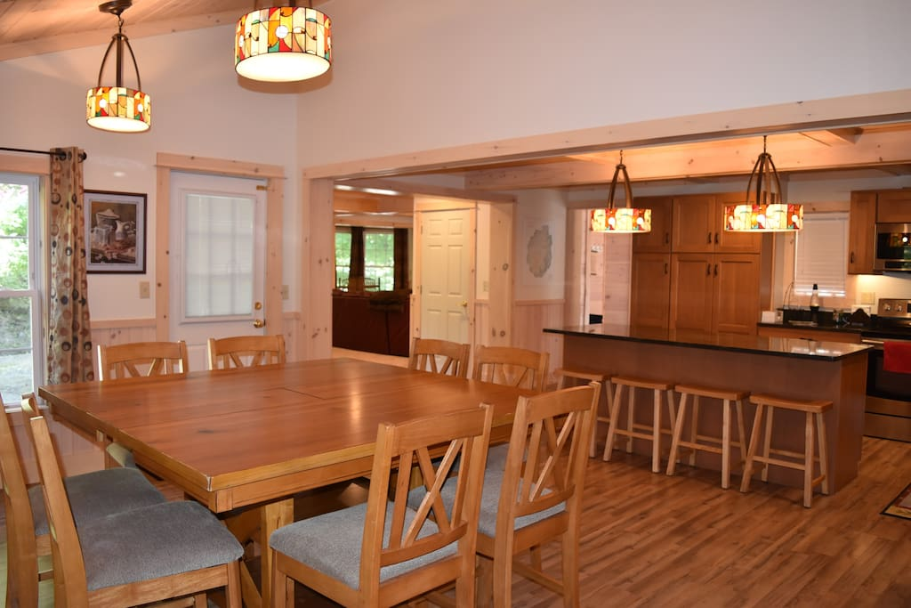Dining Room seats 8 and Kitchen island seats an additional 4 people.