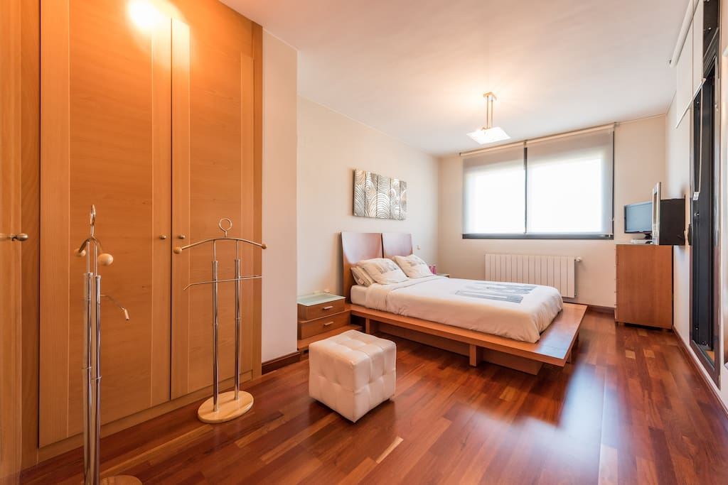 Your spacious and bright bedroom with motorized blackout roll down shutters, TV (with Chromecast) and electric fireplace @ Sierra de Madrid