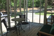 Parking area beside screened porch.