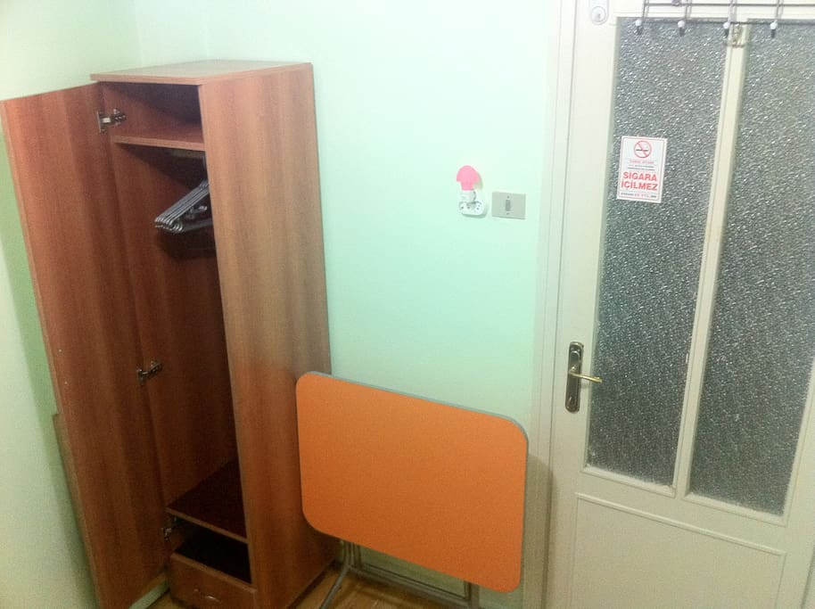 It is a quite small(~5 m2) room that offers a comfortable rest but nothing more. The room does not get direct sunlight even though there is a window. The furniture in the room: couch, wardrobe, commode, portable table and chair