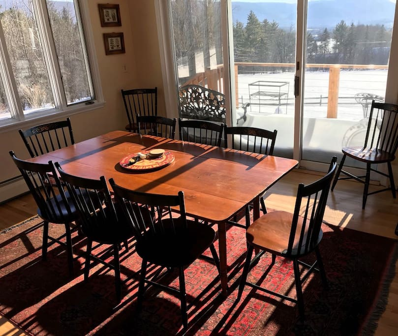 New table and chairs with seating for ten.