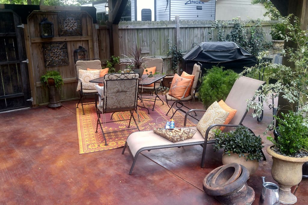 Outdoor space:  complete w/ stained concrete, BBQ grill, lighting & fans.  Plenty of seating, invite friends (adults only) ..share a bottle of vino (2 person max nightly stay)