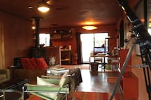 Open floor plan - living room, dining room & kitchen all flow around the wood burning stove at the center.