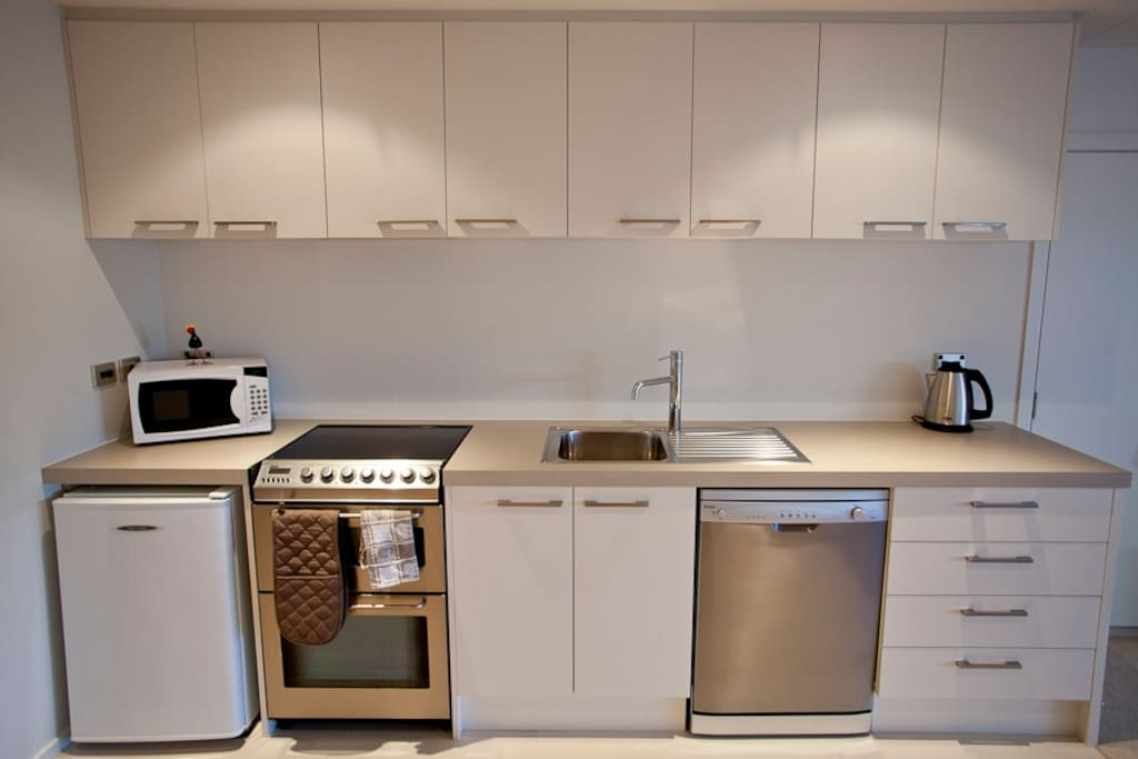 Fully fitted kitchen, including dishwasher, fridge, cooker, hob & microwave