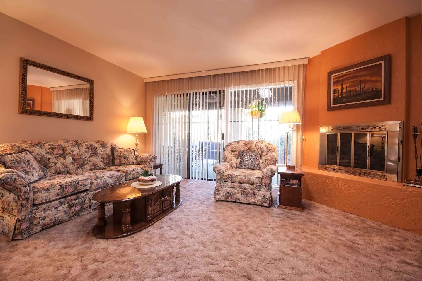 Our living room features a working fireplace and comfortable seating. It opens right onto the back patio.