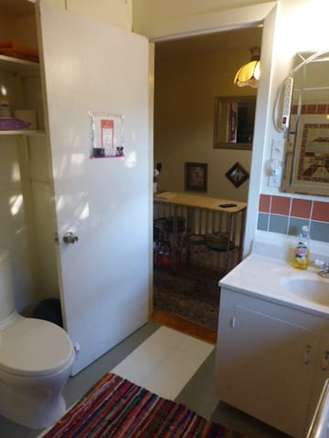Full upstairs bath, sink & storage behind door