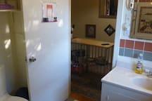 Full upstairs bath, sink & storage behind door