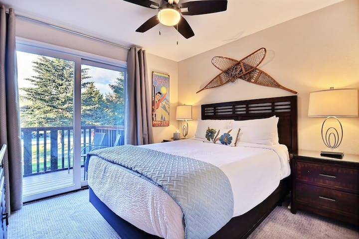 Queen Guest Suite with comfy linens and bedding,  HDTV, closet, back deck with stream views