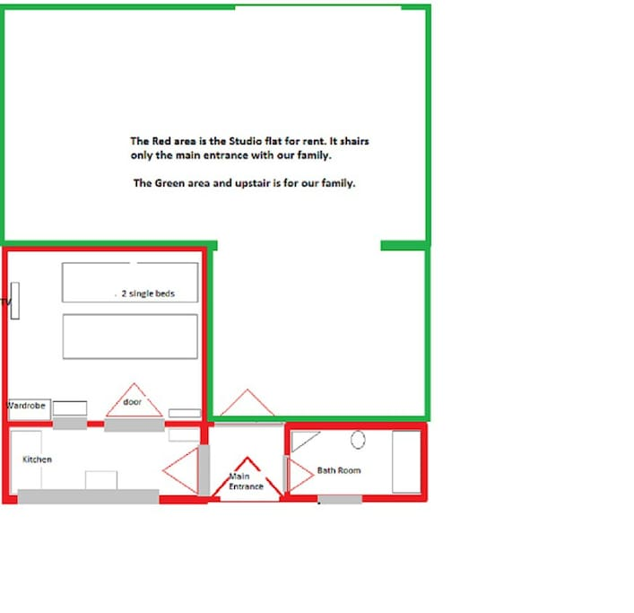The Red area in front of the house is the studio. The Green area is our family.  Sharing only the main entrance.