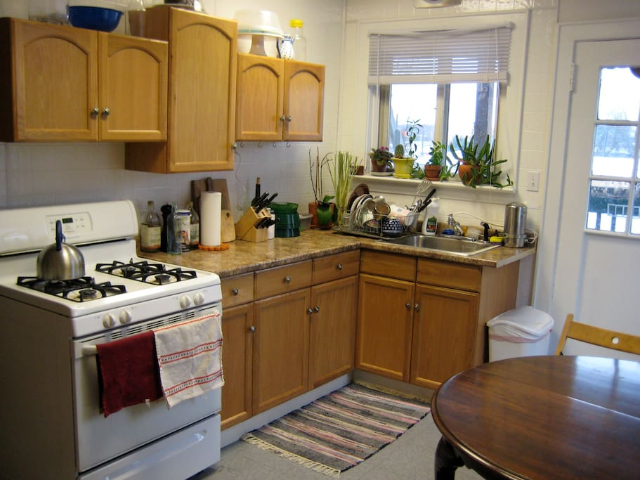 bright and sunny fully equipped kitchen- has small table for 4, but the dining room/guest room has a bigger table for 6
