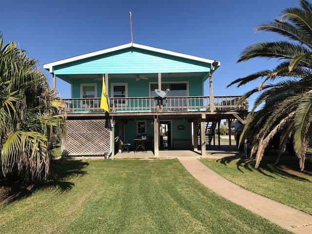 Beautiful Creek house on pilings with large downstairs storage area on right and bunkroom on left. Great covered upstairs deck and huge covered downstairs patio for relaxing and enjoying the view of Caney Creek!