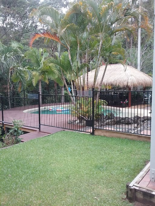 Back yard with nice grassy area leading onto he pool area.  BBQ is also avaliable.